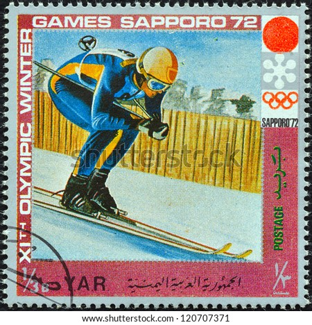 """YEMEN ARAB REPUBLIC - CIRCA 1972: A stamp printed in Yemen from the """" XI Olympic Winter Games, Sapporo"""" issue shows alpine skiing, circa 1972. - stock photo"""