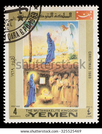 YEMEN - CIRCA 1969: A postage stamp printed in Yemen shows the Christmas Christ's Nativity with Mary and an angel, circa 1969 - stock photo