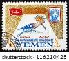 YEMEN - CIRCA 1965: A stamp printed in the Yemen shows Upupa Epops, Bird, Portrait of Imam Mohammed al-Badr, circa 1965 - stock photo