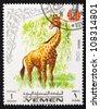 YEMEN - CIRCA 1966: A stamp printed in Yemen shows Giraffe, circa 1966 - stock photo