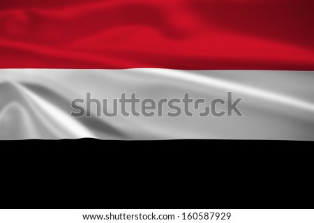 Yemen flag blowing in the wind. Background texture. - stock photo