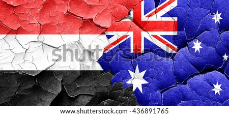 Yemen flag with Australia flag on a grunge cracked wall