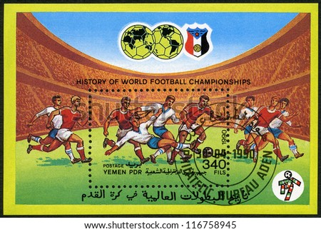 YEMEN PDR - CIRCA 1990: A stamp printed in Yemen PDR shows Soccer game, History of World Football Championships, circa 1990 - stock photo