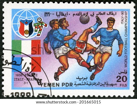 YEMEN PDR - CIRCA 1990: A stamp printed in Yemen PDR shows Soccer game, Italy, France, 1938, History of World Cup Soccer Championships, circa 1990 - stock photo