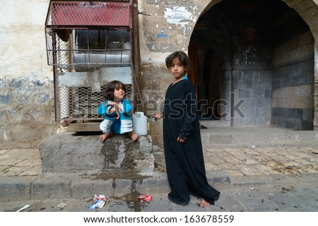 YEMEN, SANA �¢?? MAR 6: Unidentified girls use drinking water source on Mar 6, 2010 in Sana, Yemen. Girls grow up in the poorest country with little opportunity for education - stock photo