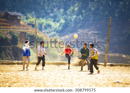 YEN BAI, VIETNAM. FEBRUARY 8, 2014. A view of kids are playing football, in mountain area. YEN BAI, VIETNAM, FEBRUARY 8, 2014.