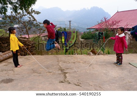 YEN BAI, VIETNAM, February 21, 2016 Hmong children, highland Yen Bai, Vietnam, playing jump rope, spring