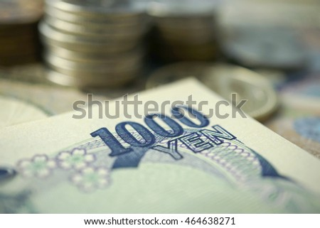yen notes and yen coins for finance concept background