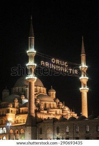 Yenicami Mosque in Eminonu, Istanbul, Turkey. The Mosque is illuminated with MAHYA specially for Ramadan.  - stock photo
