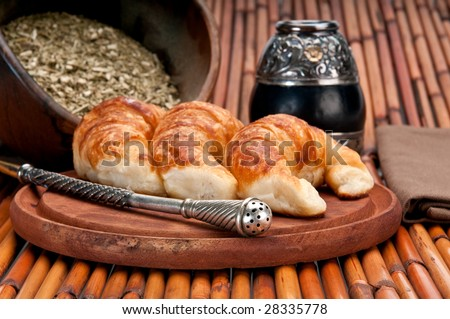 Yerba Mate and Croissants, this is a typical drink and breakfast in Argentine. Use of selective focus. - stock photo
