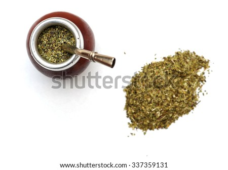 Yerba mate in a traditional calabash gourd and bag of dry herb