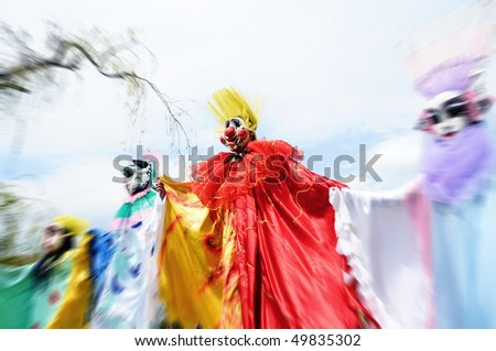 YEREVAN - MARCH 28: The clowns march at the park festival dedicated to the 75 anniversary of birth of famous Armenian clown Leonid Yengibaryan March 28, 2010 in Yerevan, Armenia. - stock photo