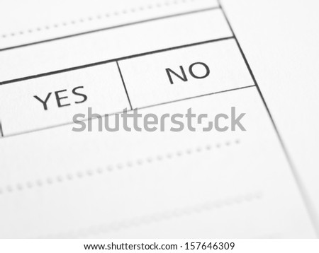 YES and NO options written on a form or contract close up. - stock photo