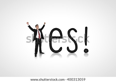 Yes! Conceptual composition of a happy expressive businessman and alphabet - stock photo