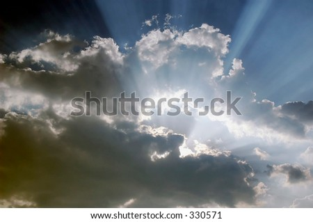 Yes God? One would think that God is trying to tell us something with these rays breaking through the clouds - stock photo