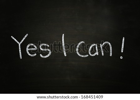 Yes I Can, Motivational Phrase written with Chalk on Blackboard - stock photo