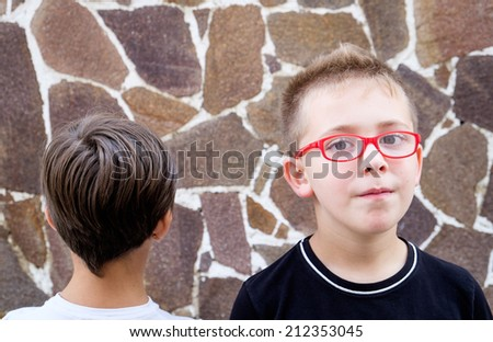 Yes & No - kids looking at opposite direction - conceptual image - stock photo