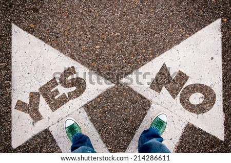 Yes or no dilemma concept with man legs from above standing on signs - stock photo
