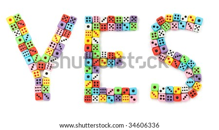 Yes sign, made of colorful dices, isolated on white