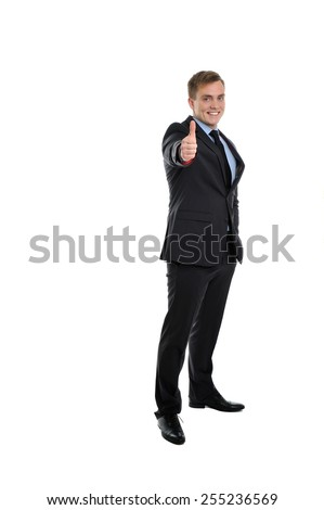 Yes! This proposal is the best. Young smiling and attractive businessman showing his thumb up.  - stock photo