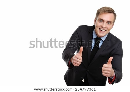 Yes! This proposal is the best. Young smiling and attractive businessman showing his thumbs up. Copy space on the left can be used for your text.  - stock photo