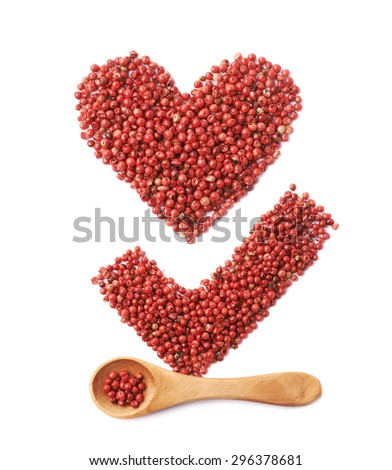 Yes tick mark sign and heart shape made of multiple red pepper seeds, composition isolated over the white background - stock photo