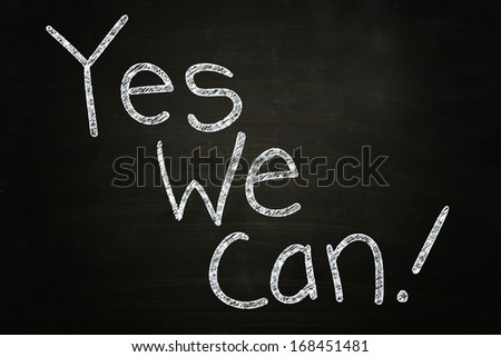 Yes We Can, Motivational Phrase written with Chalk on Blackboard