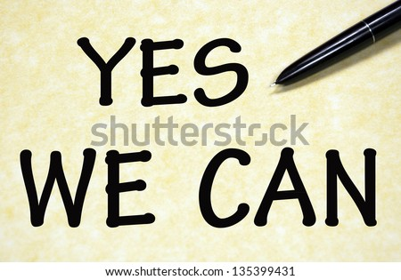yes we can title written with pen on paper - stock photo