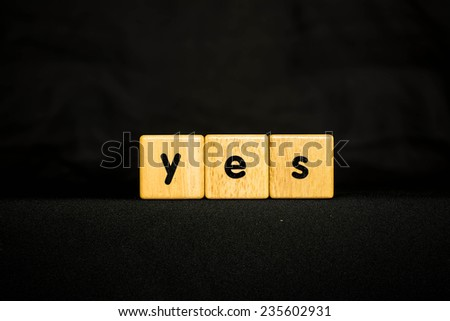yes wood Cubic on black background - stock photo