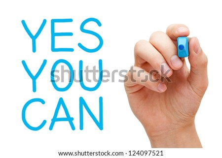 Yes You Can and hand holding blue marker. - stock photo