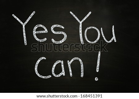 Yes You Can, Motivational Phrase written with Chalk on Blackboard - stock photo
