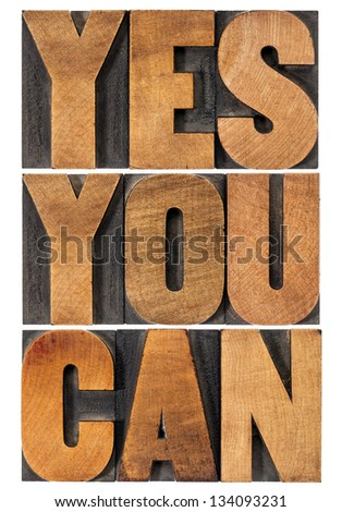 Yes you can - motivational slogan - isolated text in vintage letterpress wood type printing block, rectangular layout - stock photo