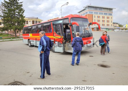 YESSENTUKI, RUSSIA - May 02.2015: Passengers await the departure of the bus tour in a tourist trip