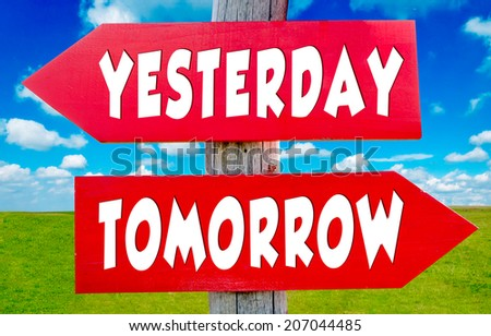 Yesterday and tomorrow concept on the red signs with landscape in background - stock photo