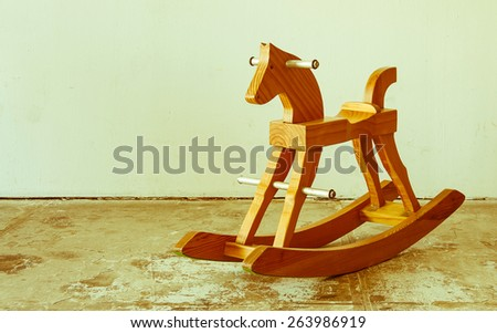 yesterday style rocking horse chair in vintage room - stock photo