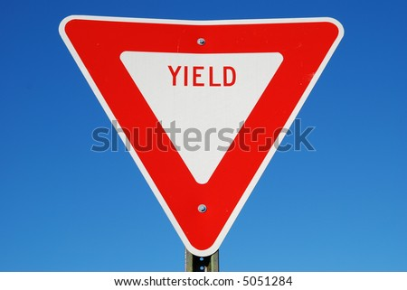 yield sign against blue sky