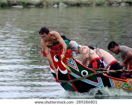 YILAN TAIWAN - June 20: red team start accelerate. Erlong River Dragon Boat Race on the Erlong River on June 20, 2015 in Yilan - stock photo