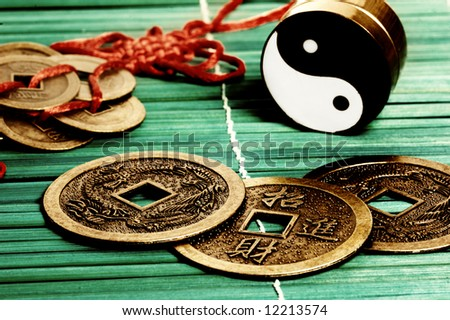 Yin yang, iChing and lucky coins, symbols of oriental meditation and divination - stock photo