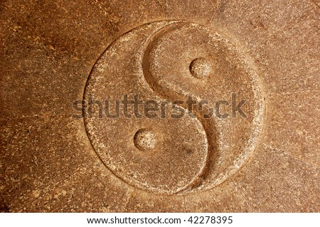 Yin Yang Symbol carved in stone - stock photo