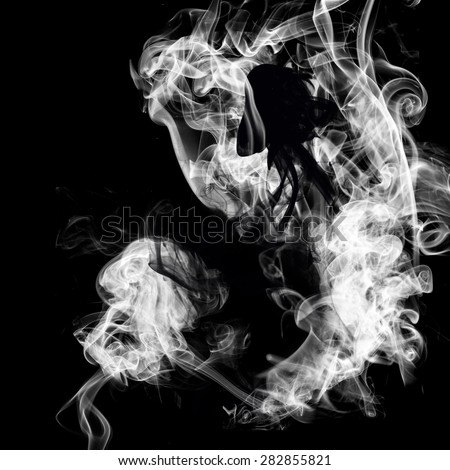 Ying Yang symbol of harmony made out of smoke on black background - stock photo