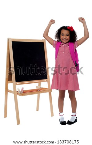 Yippee I stood first in my class. Excited girl student. - stock photo