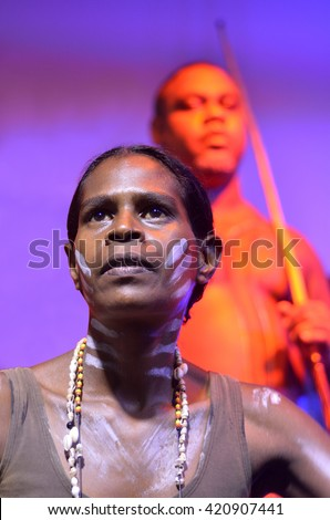 Yirrganydji Aboriginal woman and men during cultural show in Queensland, Australia. - stock photo