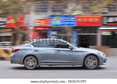 YIWU-CHINA-JAN. 20, 2016. Infiniti G37 IPL. For the first time, Infiniti sold over 215,520 vehicles annually, a 16% increase over 2014. December 2015 was also Infiniti's most successful month ever.  - stock photo