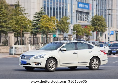 YIWU-CHINA-JAN. 26, 2016. Nissan Altima Sedan. Nissan, Japan's biggest car-maker by sales in China, said it will sell one million vehicles a year the first time as demand rebounds in China's market - stock photo