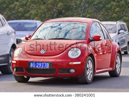 YIWU-CHINA-JAN. 26, 2016. Red Volkswagen Beetle. China is the place where VW CEO Matthias Mueller can enjoy a brief respite from its emissions scandal: The country is the automaker's biggest market. - stock photo