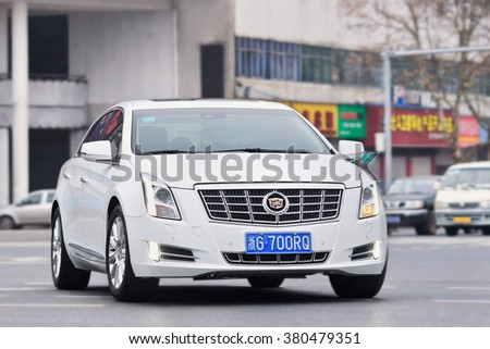 YIWU-CHINA-JAN. 8, 2016. White Cadillac CTS. Luxury-car makers can count on China's growing wealth.  Number of Chinese with over $1 million in financial assets double the North America rate this year. - stock photo