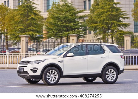 YIWU-CHINA-JAN. 26, 2016. White Land Rover Discovery. Jaguar Land Rover posted a 24% sales drop in China, caused by sharp economic slowdown and government crackdown on extravagant official spending.  - stock photo