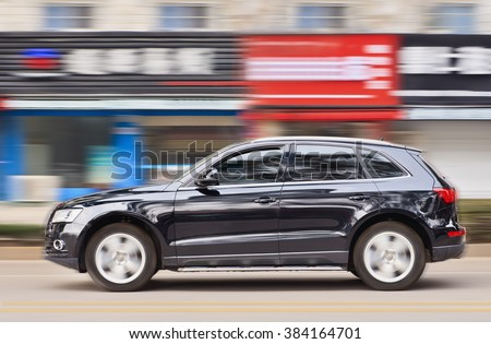 YIWU-CHINA-JANUARY 20, 2016. Audi Q5 SUV. China alone forms almost one-third of Audi's sales volume, and the German car-maker holds the dominant position in the country's premium vehicle market. - stock photo