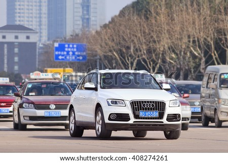 YIWU-CHINA-JANUARY 15, 2016. Audi Q5 SUV. China alone forms almost one-third of Audi's sales volume, and the German car-maker holds the dominant position in the country's premium vehicle market. - stock photo