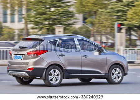 YIWU-CHINA-JANUARY 26, 2016. Beige Hyundai IX 35 SUV on the street. Hyundai car sales in China increased 11.2 percent in 2015, keeping an upward trend for the succeeded car maker from South Korea. - stock photo